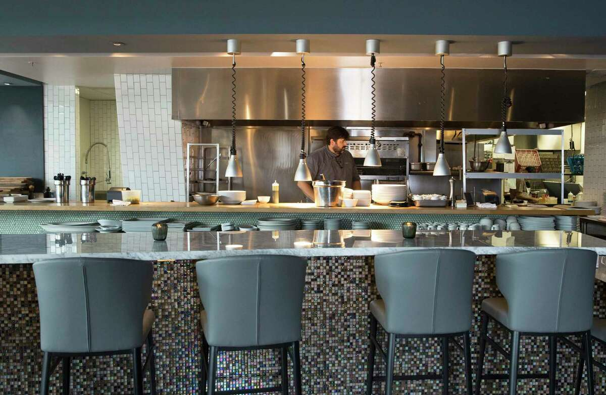 Chef-owner Bryan Caswell works in the kitchen at Reef