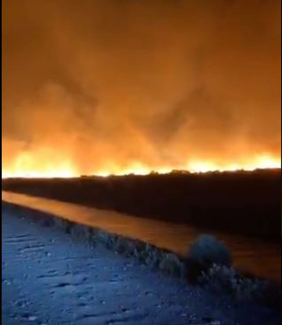 Flames from the Powerline Fire in Grant County as seen Sunday night.