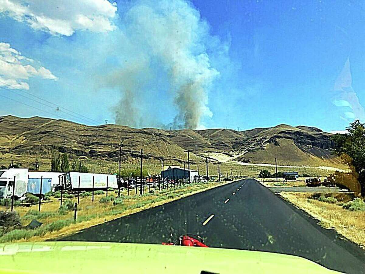 Smoke streams from the Powerline Fire in Grant County, which had torched 5,000 acres as of Monday morning.
