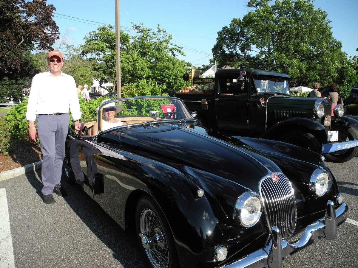 Laura and Bill Cody show off their 1959 Jaguar XK150S at the Kiwanis Club's Classic and Custom Car Show.