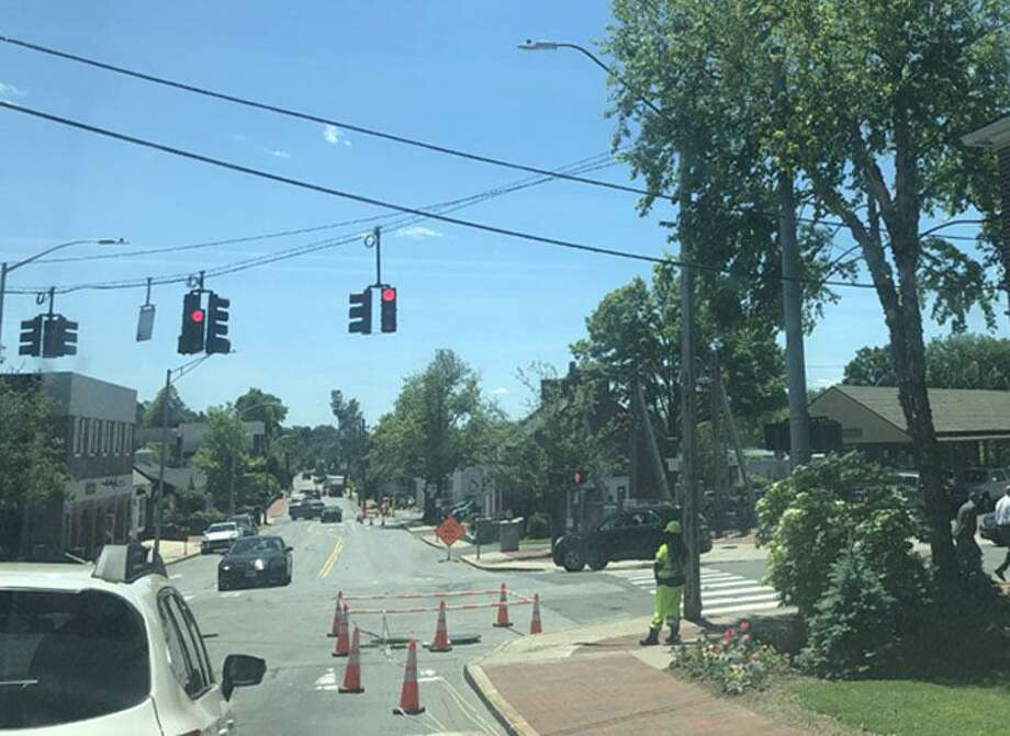 A crew from Burns Construction works on the gas expansion project for the Town of New Canaan, Connecticut, at the intersection of Elm Street, and Park Street, and Cherry Street, at Pine Street, and Park Street, in the town's downtown district, on Tuesday, June 4, 2019. Contributed photo Photo: Contributed Photo