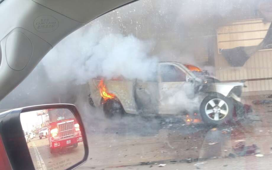 A pickup truck involved in a deadly crash is seen burning after the driver crashed into a north Houston motorcycle shop Monday, July 15, 2019. Photo: Courtesy William Terry