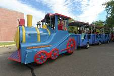 A train ride carries passengers during the third annual St. Philip Family Fall Festival at the church in Norwalk last year. The event, which features music, food, face-painting, games for children, arts, crafts and homemade items, returns Sept. 21.