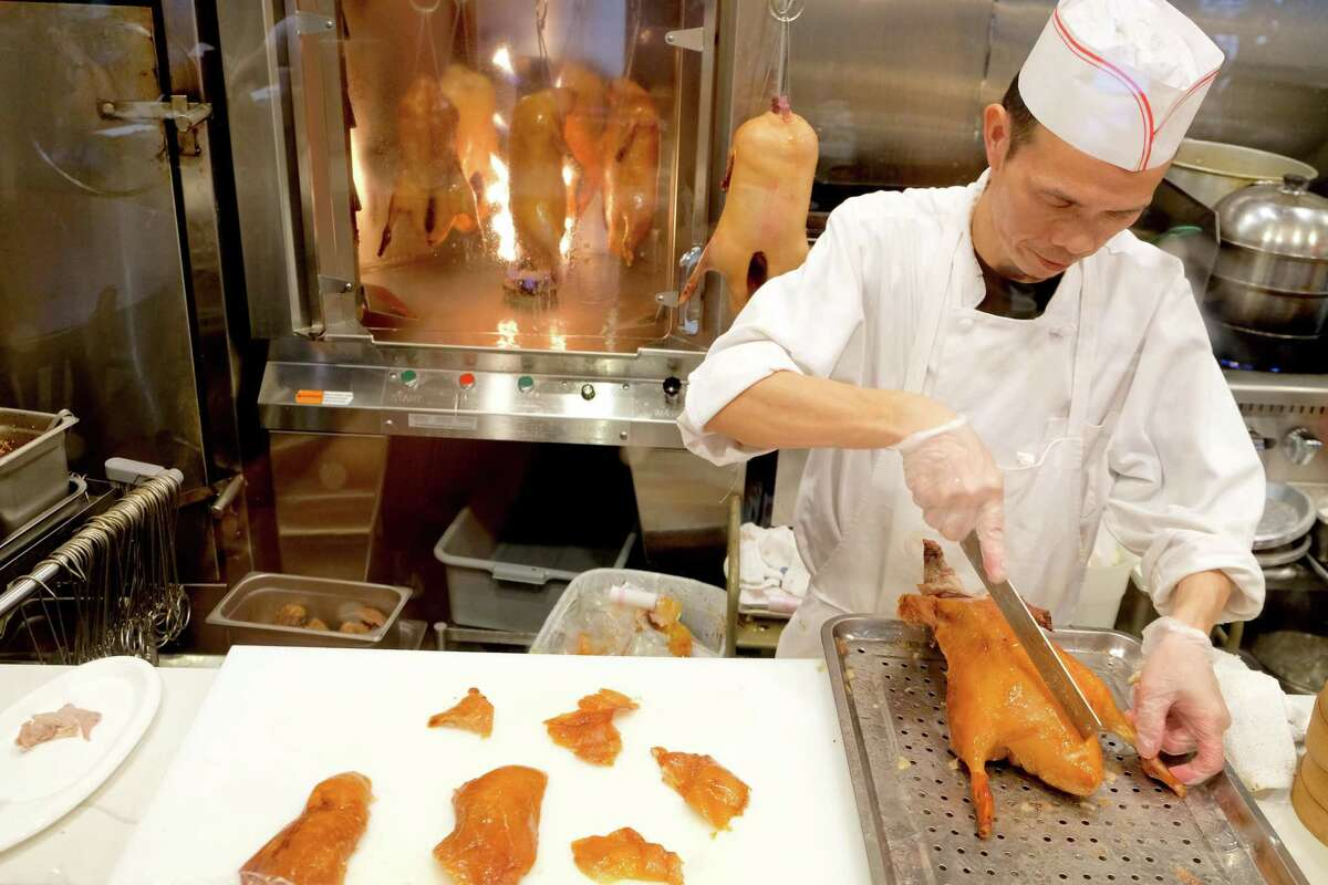Customers can see the ducks being roasted and carved in the exhibition kitchen at Bamboo House in Humble.
