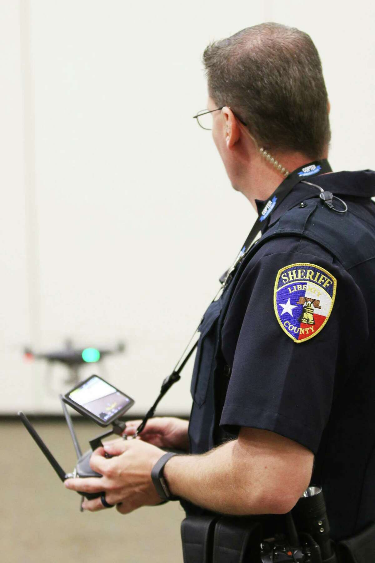Chief Pilot and Investigator Sean Mitchell last year demonstrated the Liberty County Sheriff's Office first Phantom 4 Pro Plus small unmanned aircraft or drone to Dayton Rotarians.