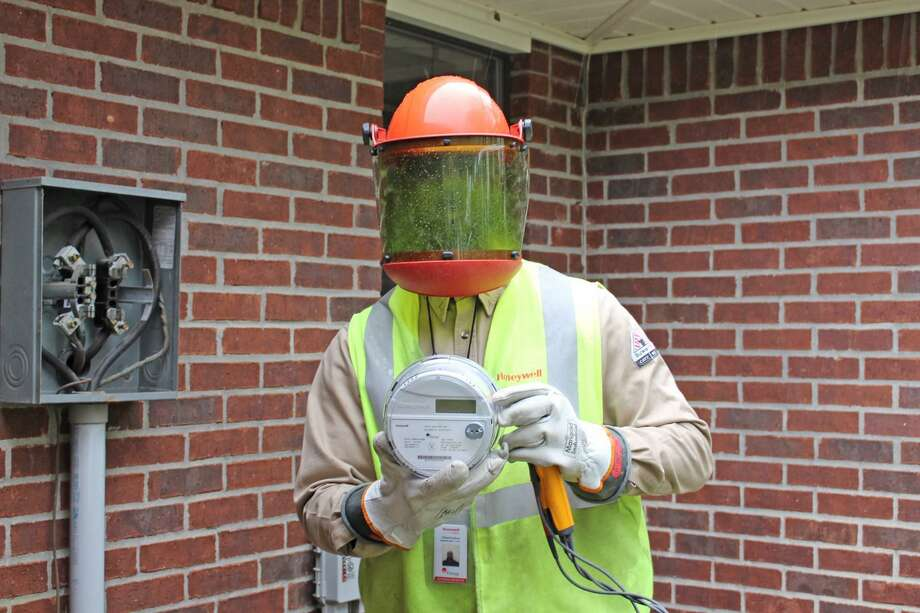 An Entergy Texas advanced meter installer demonstrates the new meters being installed in the Lumberton area. Daisetta in Liberty County will be the first to receive the new technology in late August. Photo: Submitted