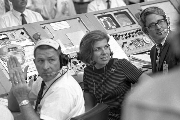 In this July 16, 1969 photo provided by NASA, JoAnn Morgan watches from the launch firing room during the launch of Apollo 11 in Cape Canaveral, Fla. Morgan, who worked on the Apollo 11 mission in 1969, went on to become the Kennedy Space Center's first female senior executive. She retired in 2003. (NASA via AP)