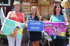 From left, State Rep. Laura Devlin, State Rep. Brenda Kupchick and Operation Hope Executive Director Carla Miklos.