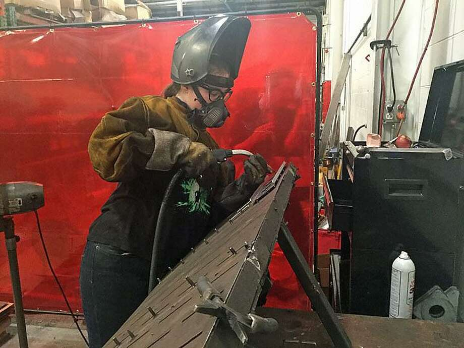 Kathryn Mica, 25, of East Haddam, has been working since April as a welder-fabricator at Sound Manufacturing in Old Saybrook, after graduating from a welding school program under the direction of the Manufacturing Pipeline Initiative. Photo: Jack Kramer / CTNewsJunkie.com