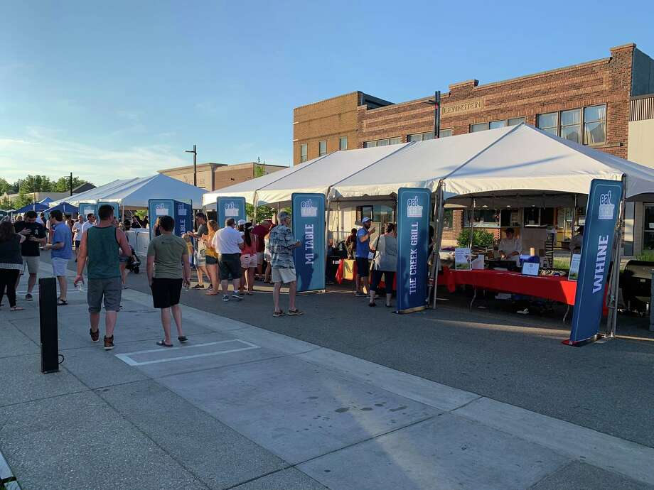 Crowds gather in downtown Midland to sample food and drinks from several establishments from across the city during the Eat Great Food Festival on July 14, 2019. (Mitchell Kukulka/Mitchell.Kukulka@mdn.net) Photo: Mitchell Kukulka