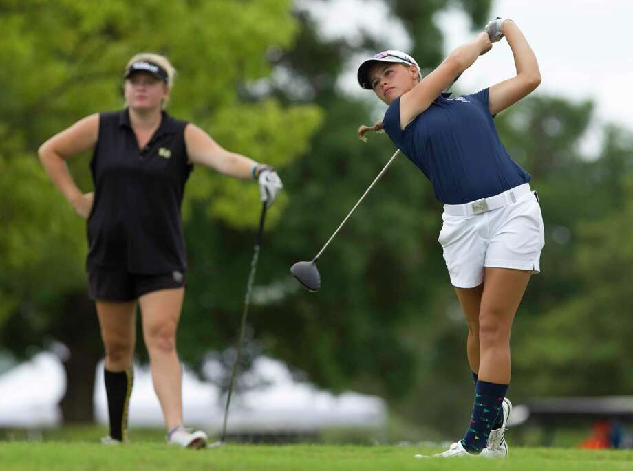 Elina Sinz of Katy Tompkins hits off the 10th tee box as Amelia McKee of Klein Oak looks on during the final round of the Class 6A UIL State Golf Championships at Legacy Hills Golf Club, Tuesday, May 22, 2018, in Georgetown. Photo: Jason Fochtman, Staff Photographer / Houston Chronicle / © 2018 Houston Chronicle