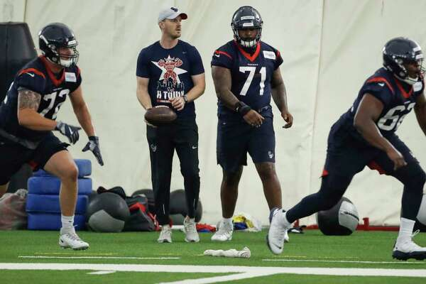 Houston Texans offensive assistant coach T.J. Yates, center left, runs offensive line drills with Rick Leonard (72), Tytus Howard (71) and D.J. Coker during mini camp at The Methodist Training Center on Tuesday, June 11, 2019, in Houston.
