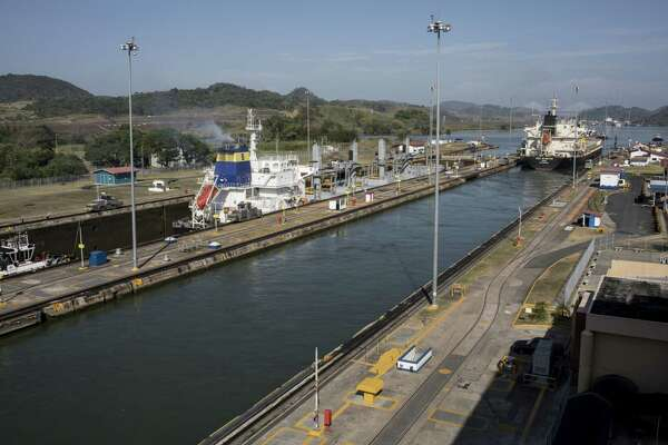The 'Chios Freedom' bulk carrier vessel crosses the Miraflores Locks of the Panama Canal in Panama City on Feb. 25, 2018.