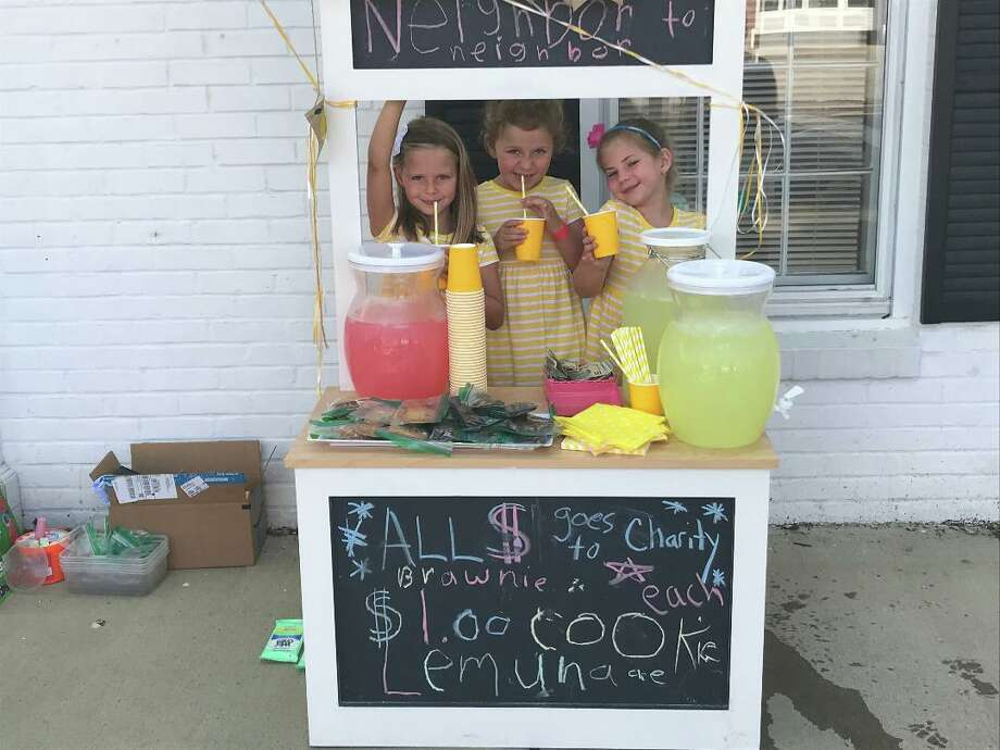 Freya Haybeck, 6; Blaire Haney, 5; and Rylie Montgomery, 6, operate a Lemonade Stand in Old Greenwich with a goal of helping the food pantry at Neighbor to Neighbor. Photo: Contributed