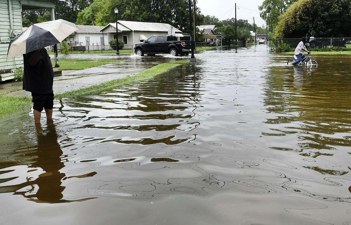 Roads flood from the rains of Barry on LA Hwy 675 in New Iberia, La., Sunday, July 14, 2019. Tropical Depression Barry dumped rain as it slowly swept inland through Gulf Coast states Sunday. (Henrietta Wildsmith/The Shreveport Times via AP)