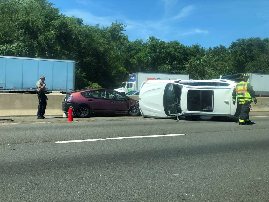 Driver, passengers escape injury after BMW rollover on I-95