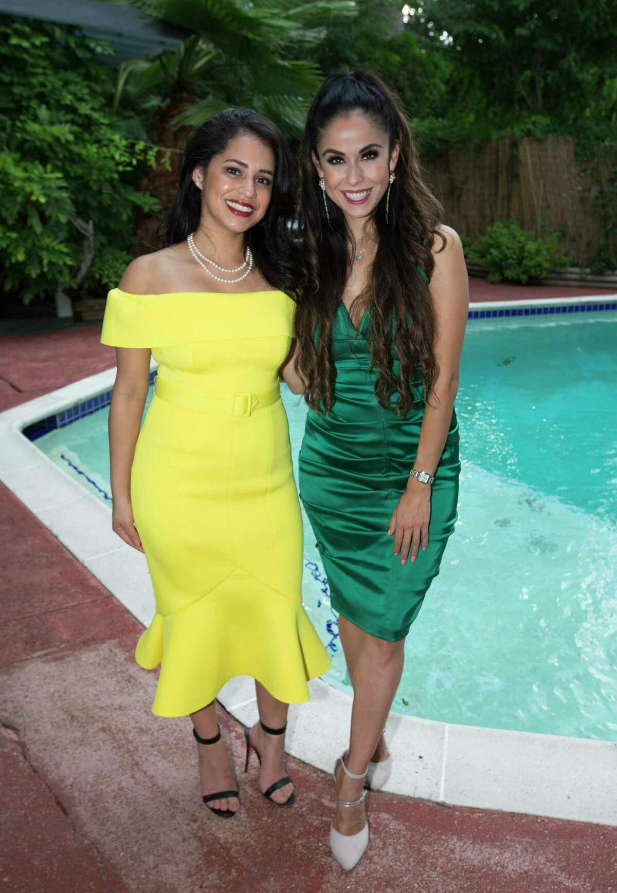 Priscilla de la Rosa, left, and Anya Reyes pose for a photograph at the Bastille Day Houston celebration on Sunday, July 14, 2019, in Houston.