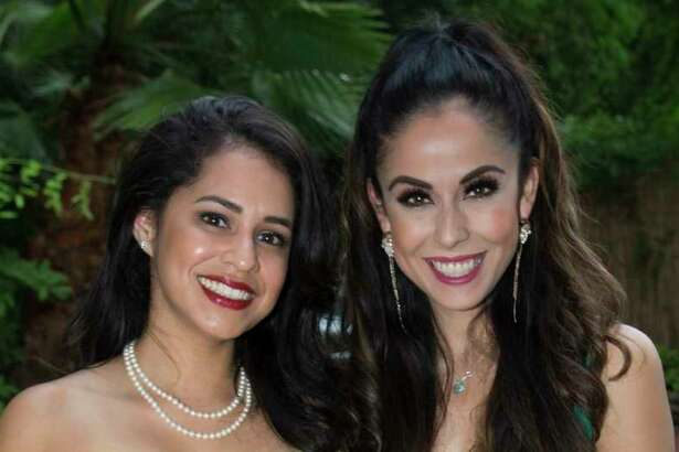 EMBARGOED TILL MONDAY JULY 15 Priscilla de la Rosa, left, and Anya Reyes pose for a photograph at the Bastille Day Houston celebration on Sunday, July 14, 2019, in Houston.