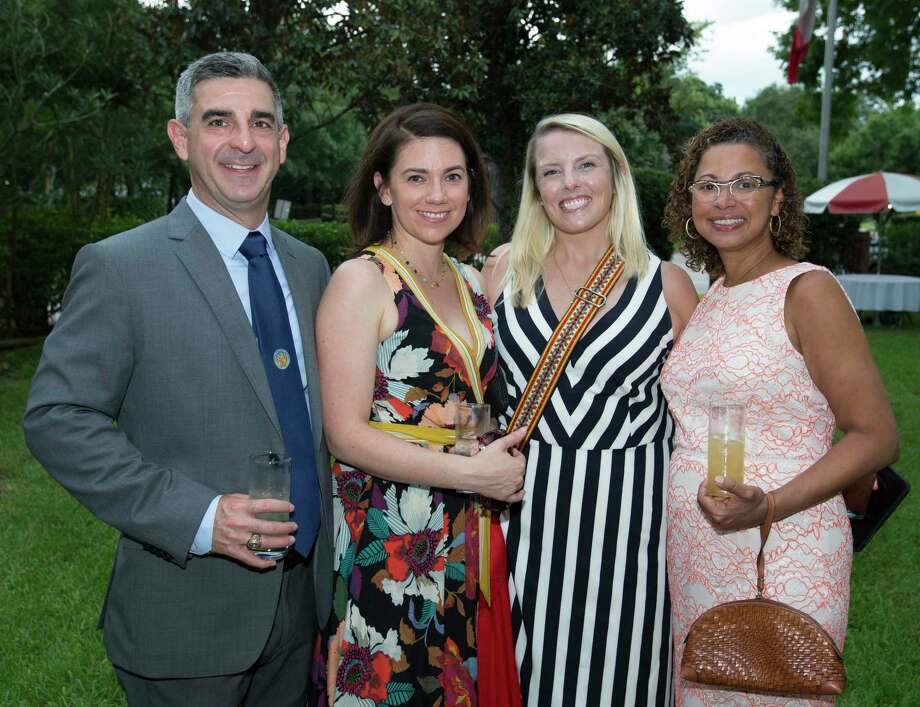 Audrey and Javier Murillo, from left, Chantel Olufsen and Soraya Diaz Tamayo pose for a photograph at the Bastille Day Houston celebration on Sunday, July 14, 2019, in Houston. Photo: Yi-Chin Lee, Staff Photographer / © 2019 Houston Chronicle