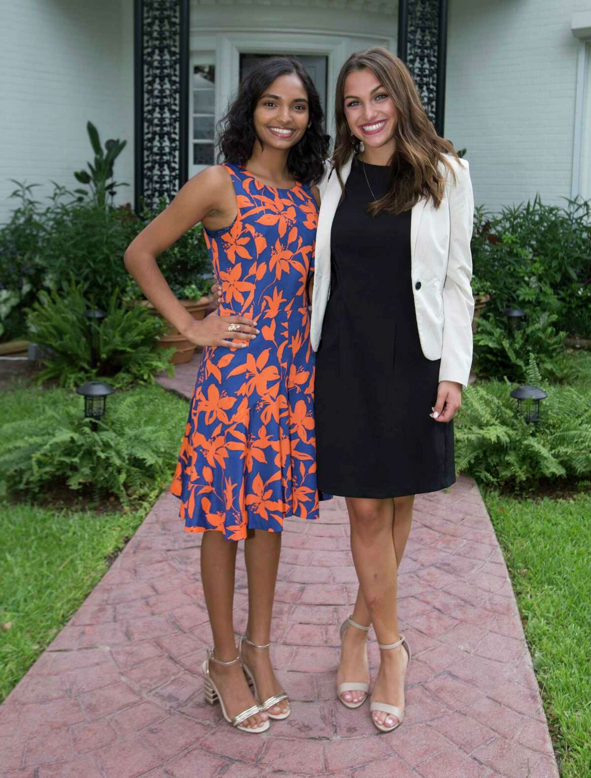 Nandini Kommana, left, and Camryn Harper pose for a photograph at the Bastille Day Houston celebration on Sunday, July 14, 2019, in Houston.