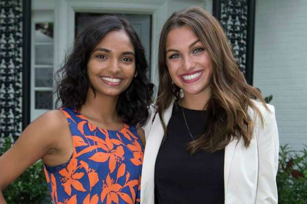 EMBARGOED TILL MONDAY JULY 15 Nandini Kommana, left, and Camryn Harper pose for a photograph at the Bastille Day Houston celebration on Sunday, July 14, 2019, in Houston.