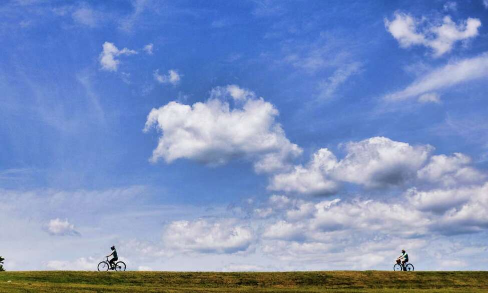 Bicyclists make their way along the bike trail on Monday, July 15, 2019, in Niskayuna, N.Y. (Paul Buckowski/Times Union)