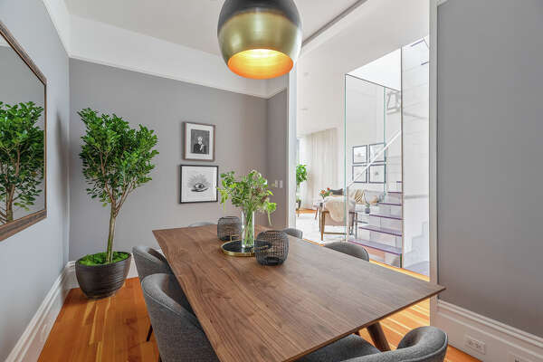 Real estate agent Lamisse Droubi said that most of the prospective buyers of this modernized Victorian on 23rd Street in Noe Valley did not like the partially enclosed dining room. They asked about taking out the walls. (Photos courtesy of Open Homes Photography.)