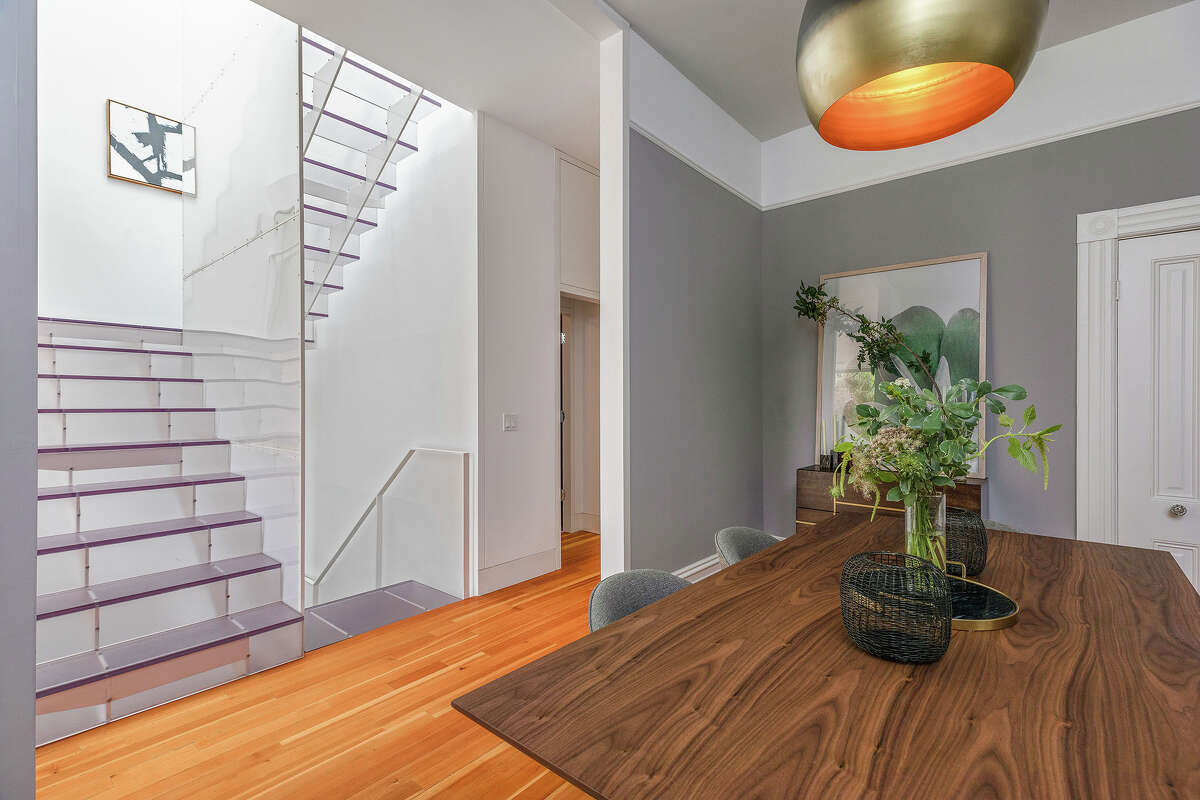 While some people like to see separation between the dining room and kitchen, real estate agent Lamisse Droubi said they are definitely the minority. The gray wall in the back may not be around for much longer. (Photos courtesy of Open Homes Photography.)