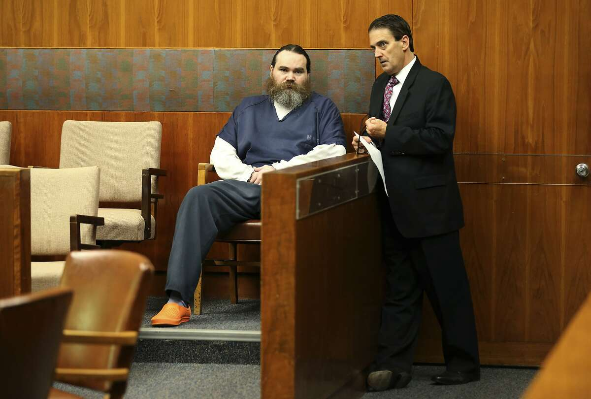 Shaun Gallon speaks with his attorney Deputy Public Defender Jeff Mitchell during a sentencing hearing, Monday, July 15, 2019, in Santa Rosa, Calif. Gallon sentenced to life in prison for killing an engaged couple from Ohio while they were camping on a Northern California beach in 2004. (Beth Schlanker/The Press Democrat via AP)