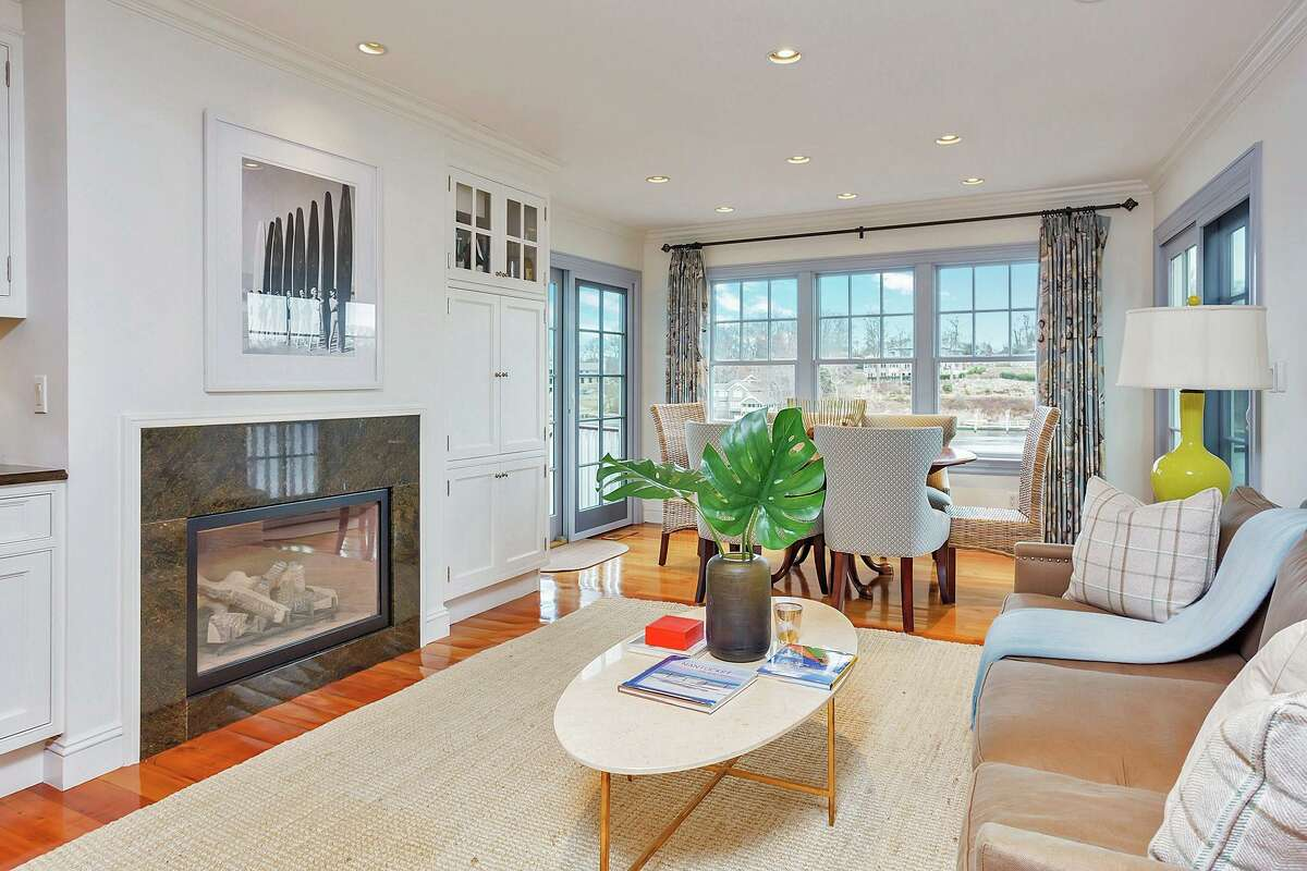 Open to the kitchen is a sitting room with a gas log fireplace and a casual dining area or breakfast nook.