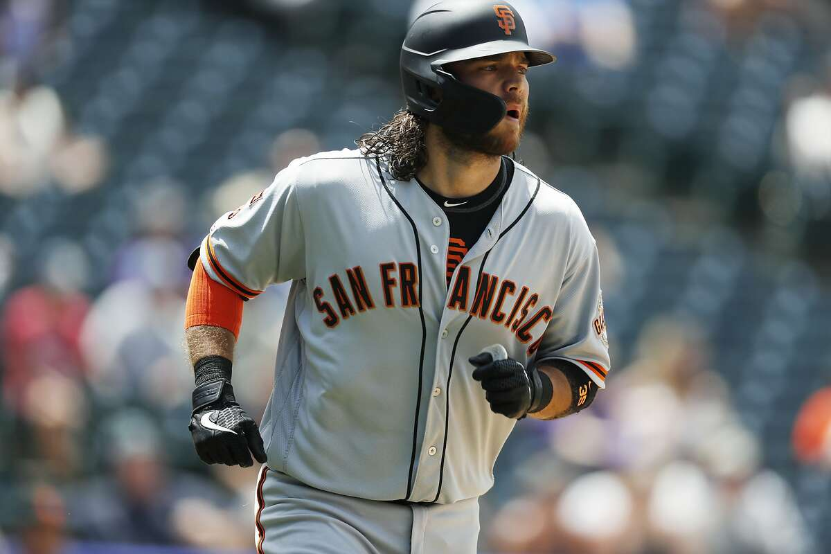 San Francisco Giants' Brandon Crawford heads up the first base line after hitting a two-run home run off Colorado Rockies relief pitcher Jesus Tinoco in the sixth inning of a baseball game Monday, July 15, 2019, in Denver.