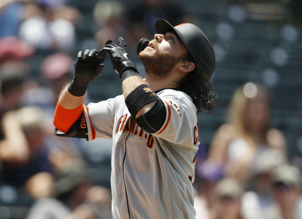 San Francisco Giants' Brandon Crawford gestures as he crosses home plate after hitting a two-run home run off Colorado Rockies relief pitcher Jesus Tinoco in the sixth inning of a baseball game Monday, July 15, 2019, in Denver.
