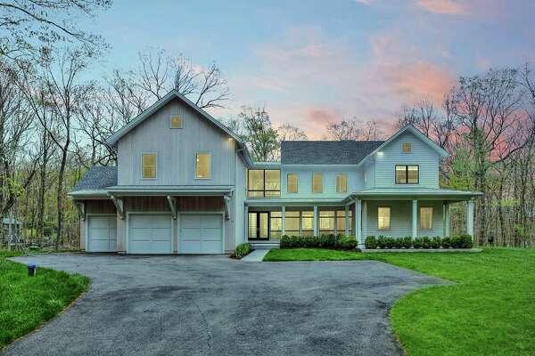 The newly constructed modern colonial farmhouse at 11 Old Hyde Road sits on a two-acre largely level property in the center of town.