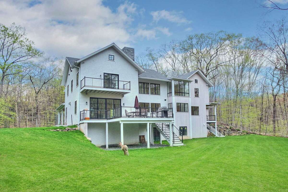 This house features two raised decks and a balcony off the second floor master suite.
