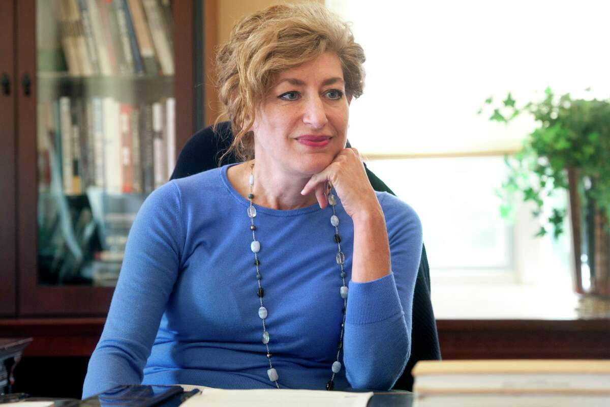 University of Connecticut President Susan Herbst speaks in her office during an interview in Storrs, Conn. Aug. 20, 2018. Herbst has announced that she will leave the university at the end of this academic year.