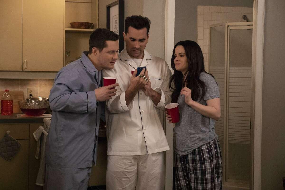 "Noah Reid, Daniel Levy, Emily Hampshire in Ep. 505 - ""Housewarming"" of Schitt's Creek, a TV series created by CBC."