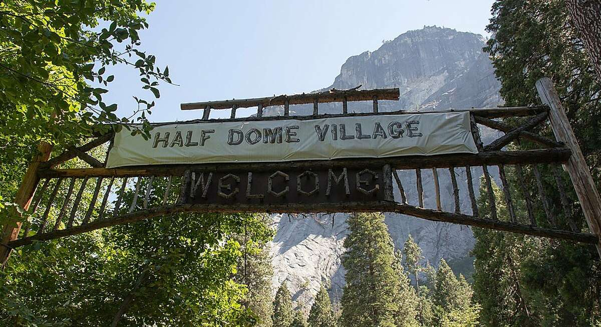 A sheet of plastic covers the original sign for Camp Curry Village in Yosemite National Park.