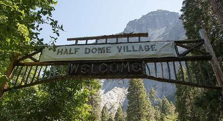 A sheet of plastic covers the original sign for Camp Curry Village in Yosemite National Park. Photo: Courtesy National Park Service