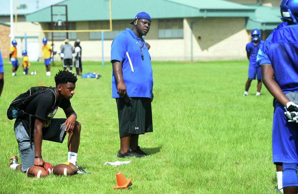 Ozen's Ed Taylor, center, runs the team through drills during the season's first day of practice on Monday. Photo taken Monday August 01, 2016 Guiseppe Barranco/The Enterprise