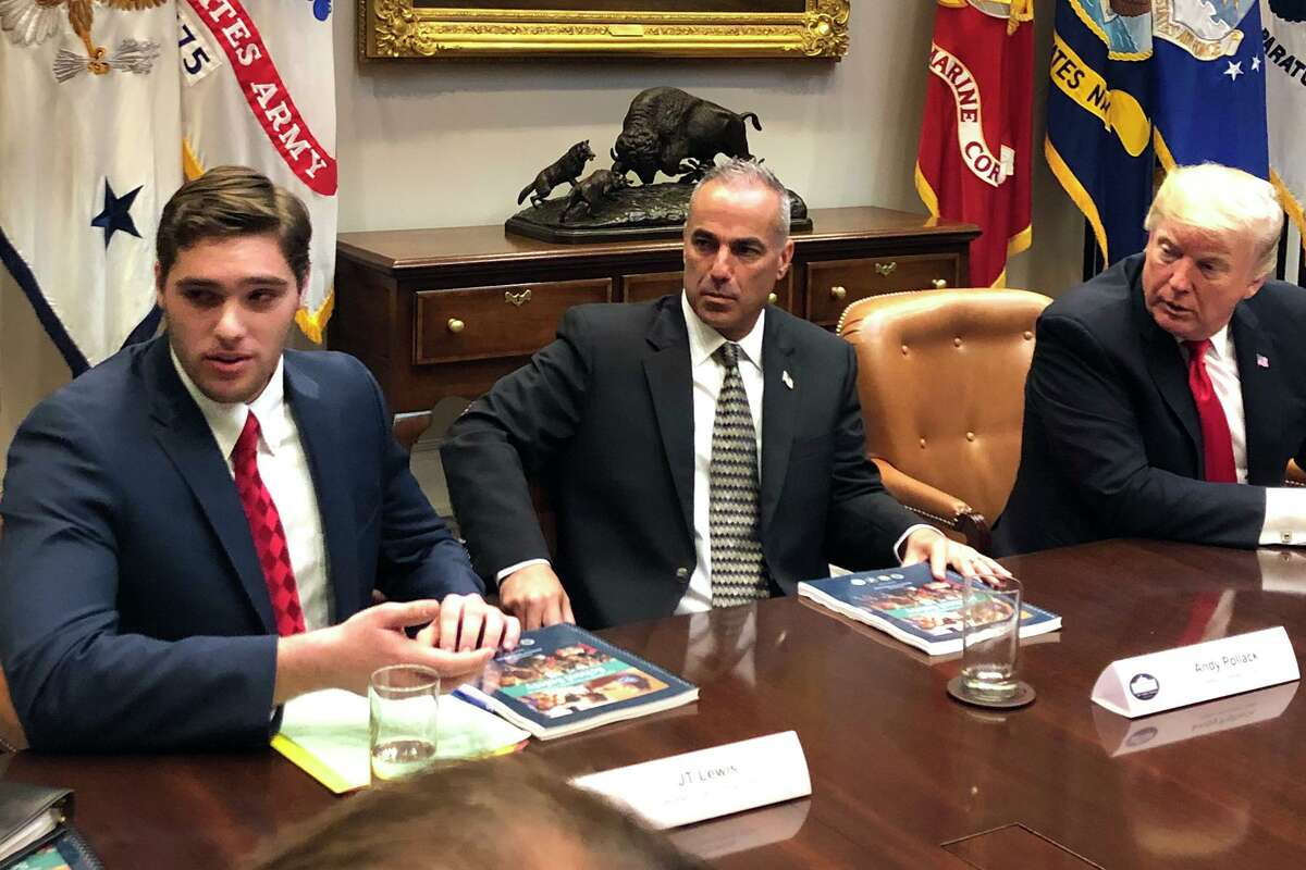 JT Lewis, left, who lost his little brother Jesse at Sandy Hook, speaks at a round table White House meeting on school safety with a President Trump at the White House on Dec. 18, 2018. Lewis plans to run for state Senate.