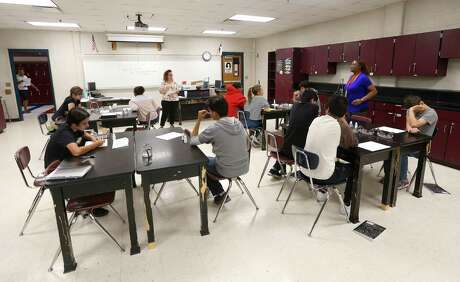 Students prepare to conduct a science experiment Thursday at Woodlake Hills Middle School during the Writing for Science summer program offered by Judson ISD. The district is expanding summer offerings to help students stay engaged and learning throughout the year.