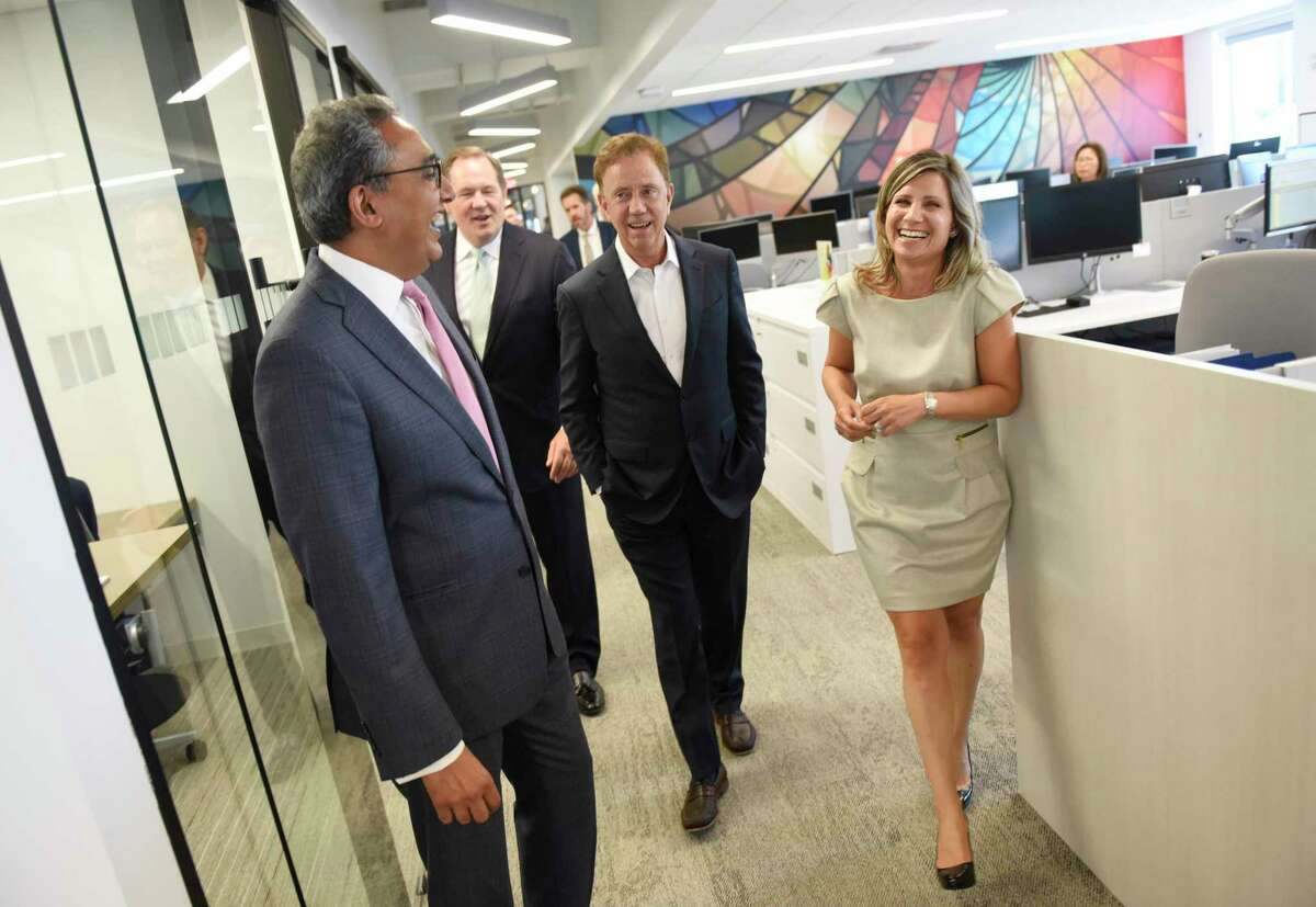 Gov. Ned Lamont, third from left, tours KPMG with Office Managing Partner Manish Madhavani, left, New York Office Managing Partner Bob Garrett, and Tax Managing Director Catherine Maldari after the ribbon-cutting at the professional service firm's new office in Stamford on Monday. The welcome was attended by Lamont and Mayor David Martin to show the new office at 677 Washington Blvd., the space formerly used by UBS.