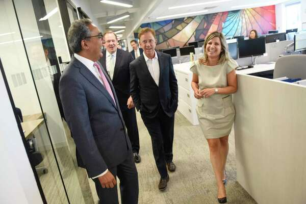 Connecticut Gov. Ned Lamont, third from left, tours KPMG with Office Managing Partner Manish Madhavani, left, New York Office Managing Partner Bob Garrett, and Tax Managing Director Catherine Maldari after the ribbon-cutting at the professional service firm's new office in Stamford, Conn. Monday, July 15, 2019. The welcome was attended by Connecticut Governor Ned Lamont and Stamford Mayor David Martin to show the new office at 677 Washington Blvd., the space formerly used by UBS.