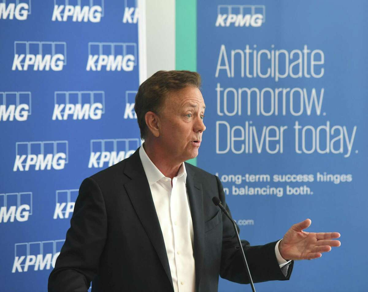Gov. Ned Lamont speaks during the ribbon-cutting at the KPMG professional service firm's new office in Stamford on Monday.