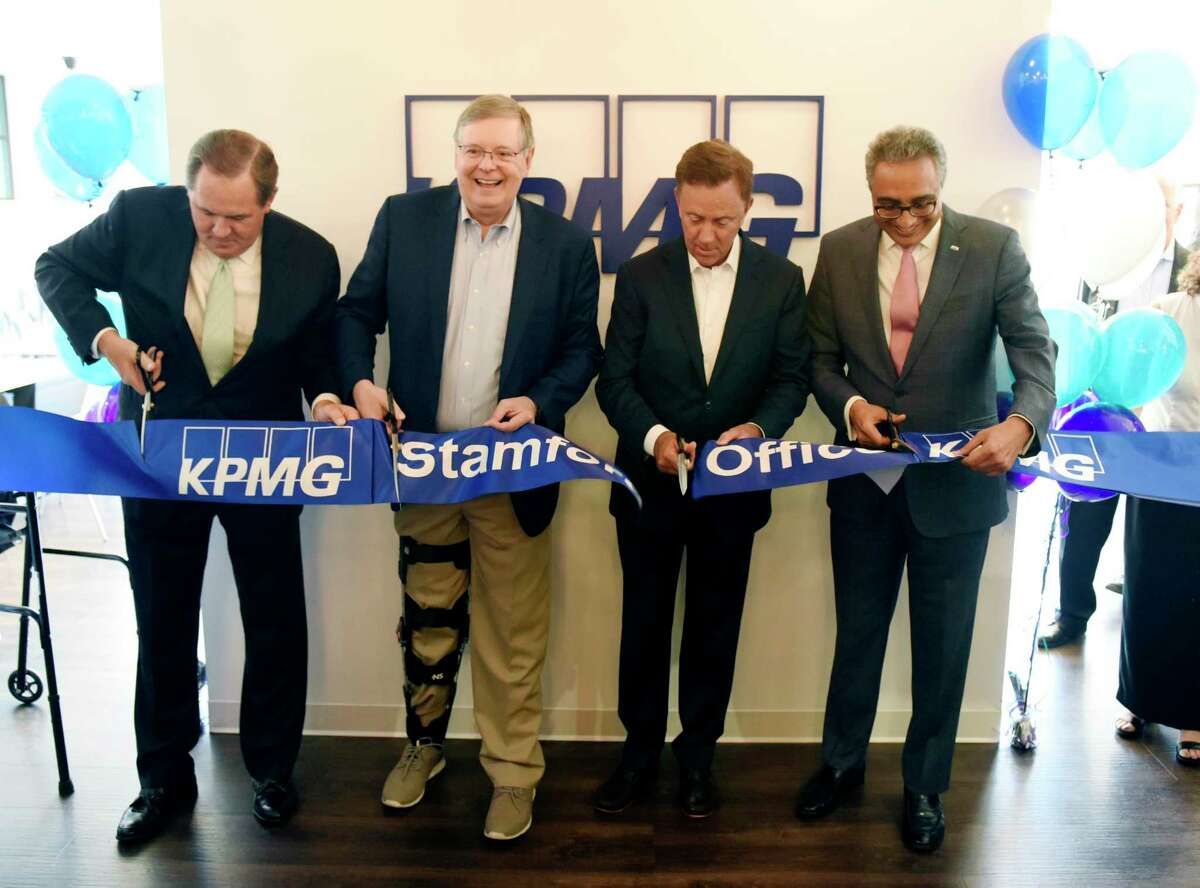From left, New York Office Managing Partner Bob Garrett, Stamford Mayor David Martin, Connecticut Gov. Ned Lamont, and Office Managing Partner Manish Madhavani, cut the ribbon the welcome the KPMG professional service firm's new office to Stamford, Conn. Monday, July 15, 2019. The welcome was attended by Connecticut Governor Ned Lamont and Stamford Mayor David Martin to show the new office at 677 Washington Blvd., the space formerly used by UBS.