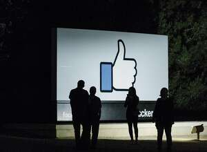 FILE -- The Facebook campus in Menlo Park, Calif., April 9, 2018. After the social network was hit on Friday, July 12, 2019, with a fine of around $5 billion for privacy violations, critics immediately said it escaped largely unscathed: The settlement neither bruised its bottom line nor severely restricted its ability to collect people's data. Yet even if the Silicon Valley company dodged that bullet, its pain was just beginning. (Jason Henry/The New York Times)