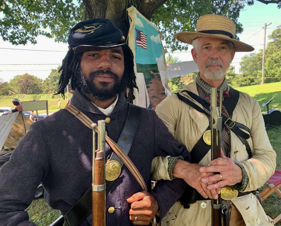 Civil War re-enactors Marquett Milton, left, and Michael Schaffner at Fort Stevens Park for the anniversary of the 1864 Battle of Fort Stevens in Washington, D.C. July 13, 2019. Photo: Washington Post Photo By John Kelly. / The Washington Post