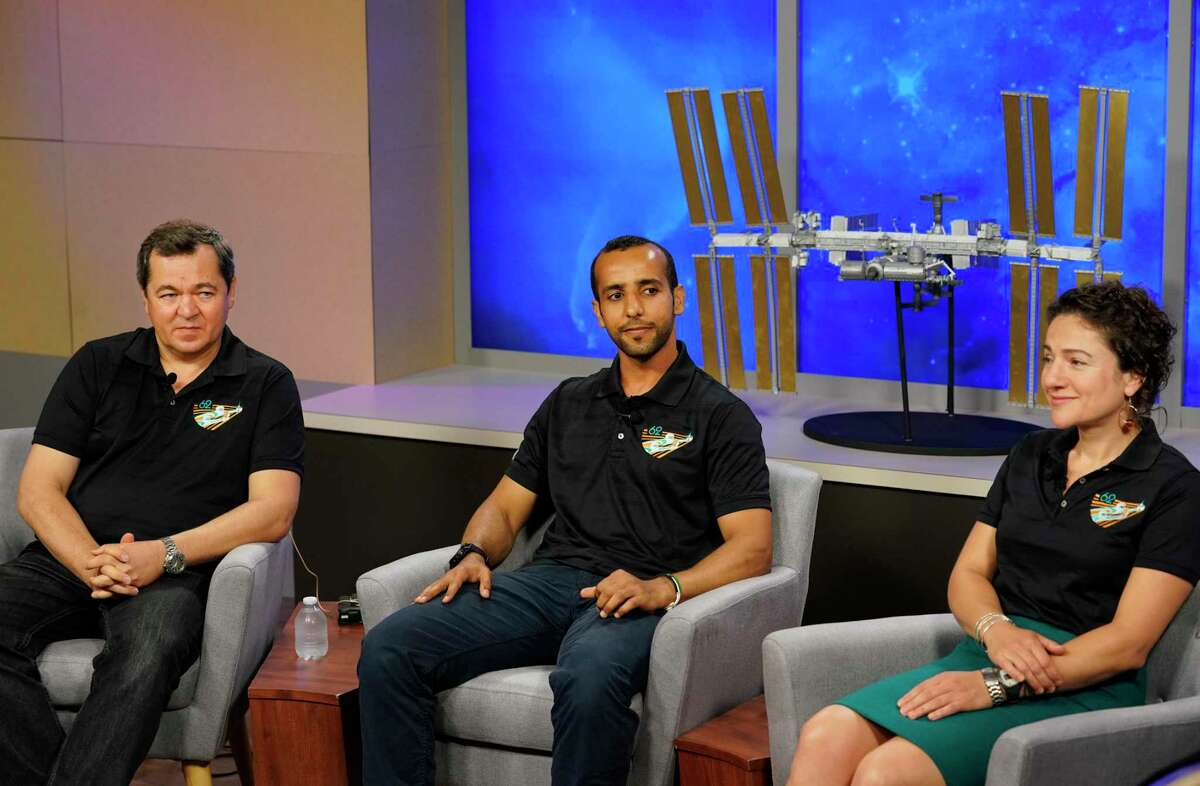 Oleg Skripochka of the Russian space agency Roscosmos, left, Hazzaa Al Mansoori of the United Arab Emirates, a Roscosmos spaceflight participant, and NASA astronaut Jessica Meir, right, are shown during the International Space Station Expedition 61-62 crew news conference at Johnson Space Center Monday, July 15, 2019, in Houston. They are scheduled to launch Sept. 25 for the International Space Station aboard the Soyuz MS-15 spacecraft from the Baikonur Cosmodrome in Kazakhstan. Al Mansoori will be the first Emirati astronaut on the space station.