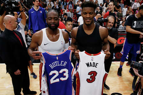Dwyane Wade, middle left, of the Miami Heat exchanges jerseys with Jimmy Butler of the Philadelphia 76ers after a game at American Airlines Arena in Miami on April 9, 2019. (Michael Reaves/Getty Images/TNS) **FOR USE WITH THIS STORY ONLY**