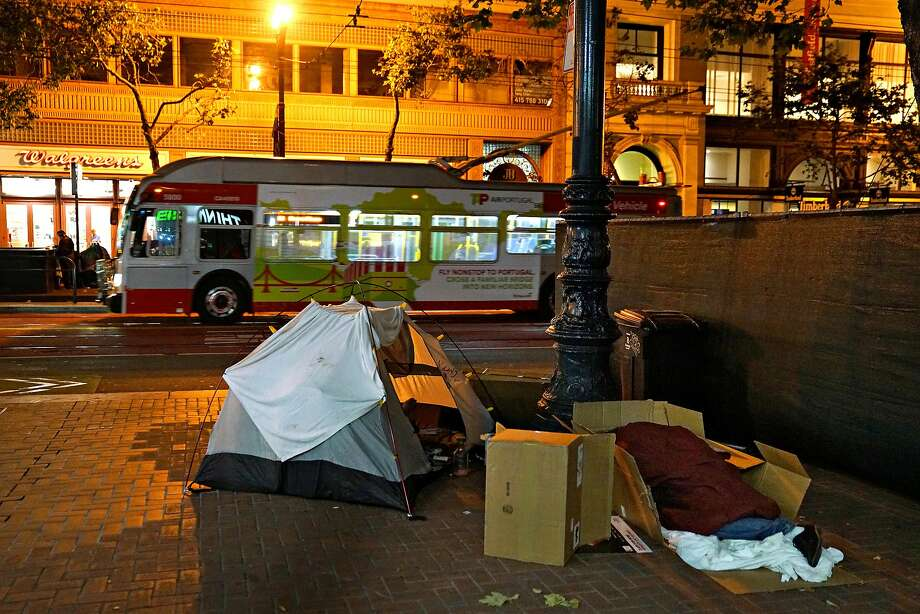 A tent is set up in the 800 block of Market Street in San Francisco, outside the entrance to a BART station. The homeless count has soared in the city, rising 30 percent in two years. Photo: Guy Wathen / The Chronicle